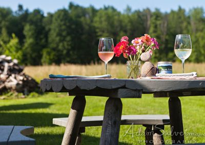 Sunny picnic table with wine glasses