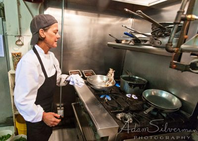 Chef Phoebe Bright tossing food in a pan
