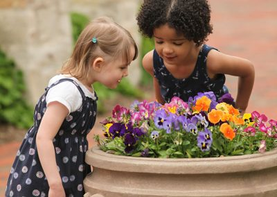 Two girls looking at flowers