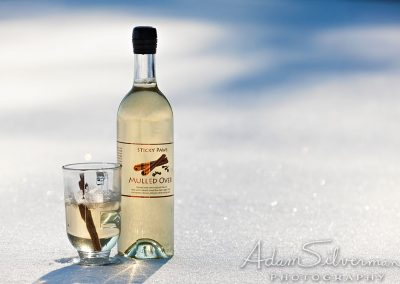 Cinnamon spiced mead on a snowy backdrop